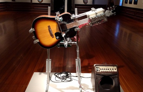 Arduino this guitar playing robot performs american