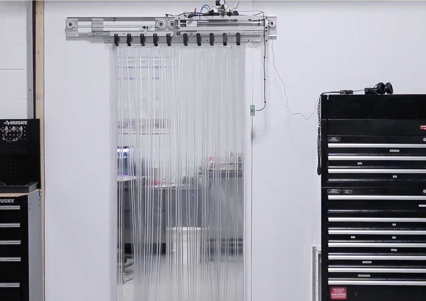 In order to separate their office and shop areas NYC CNC installed a rubber strip assembly that had to be pushed out of the way every time someone wanted ... & Arduino Blog » Automate a rubber strip door with Arduino