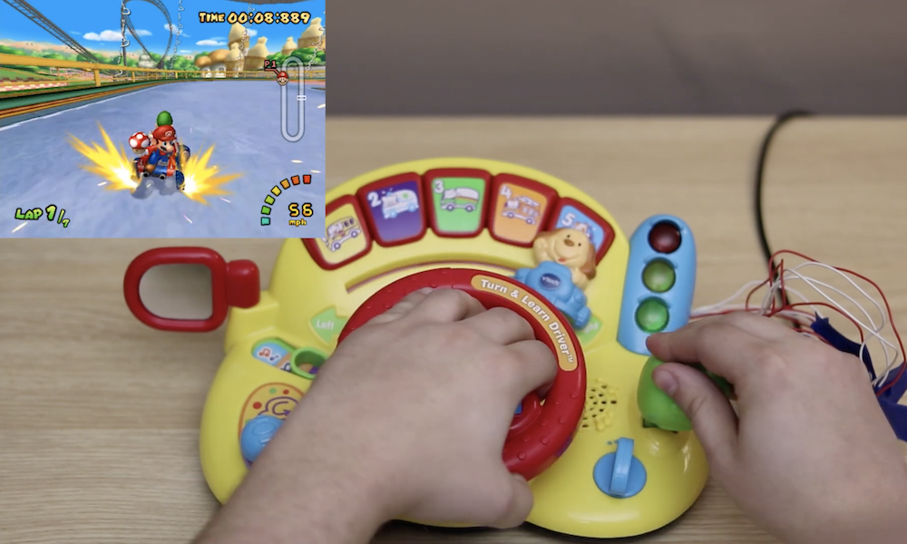 Play Mario Kart: Double Dash with a hacked VTech steering wheel