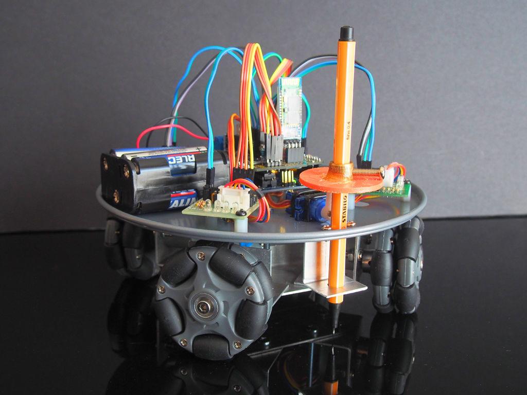 Arduino Blog » Omni-wheel robot slides across the paper as a