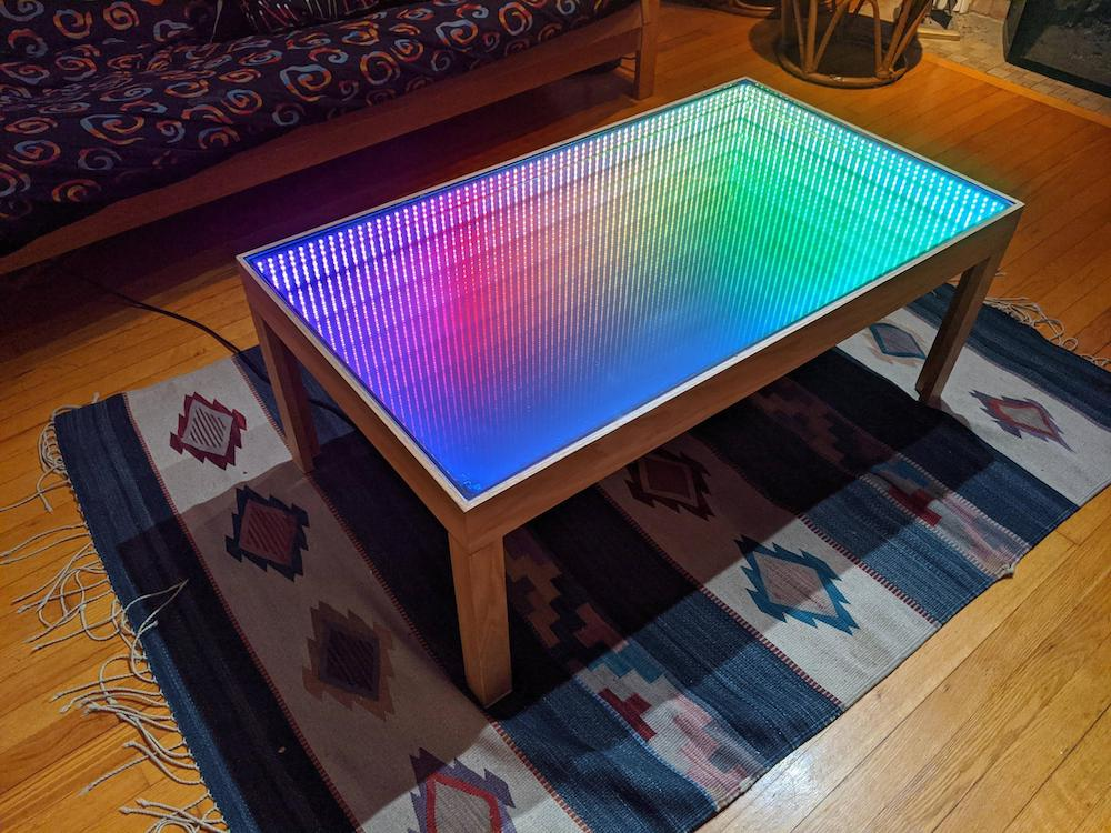 This Infinity Mirror Coffee Table Puts, Mirrored Living Room Furniture Set